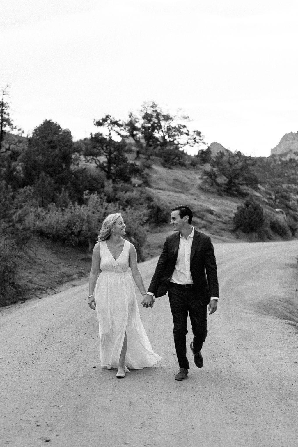 couple walking through garden of the gods