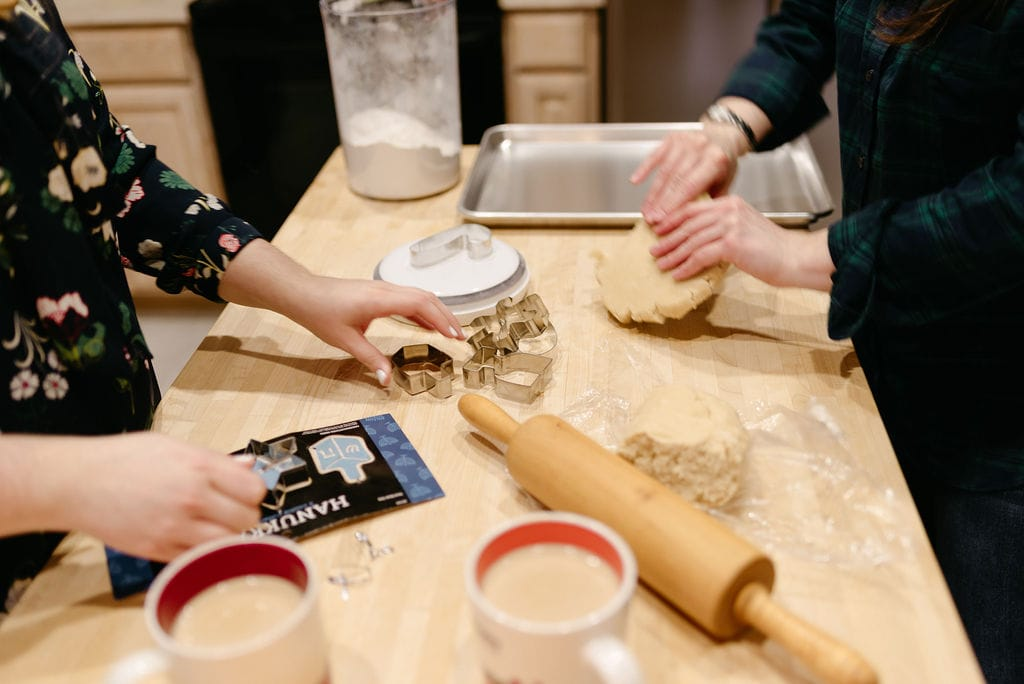 LGBTQ couple makes cookies in the kitchen