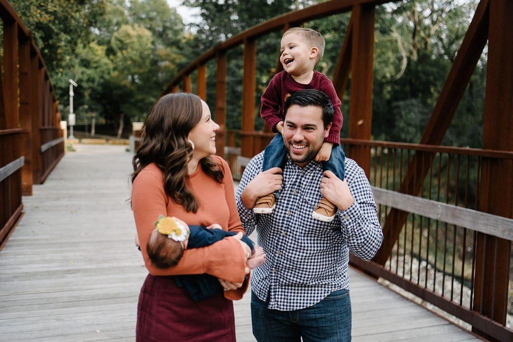 Family photos on a bridge