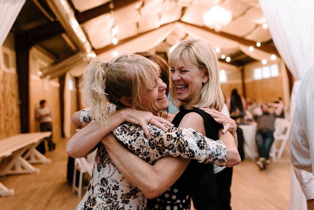 friends having fun at rustic lace barn