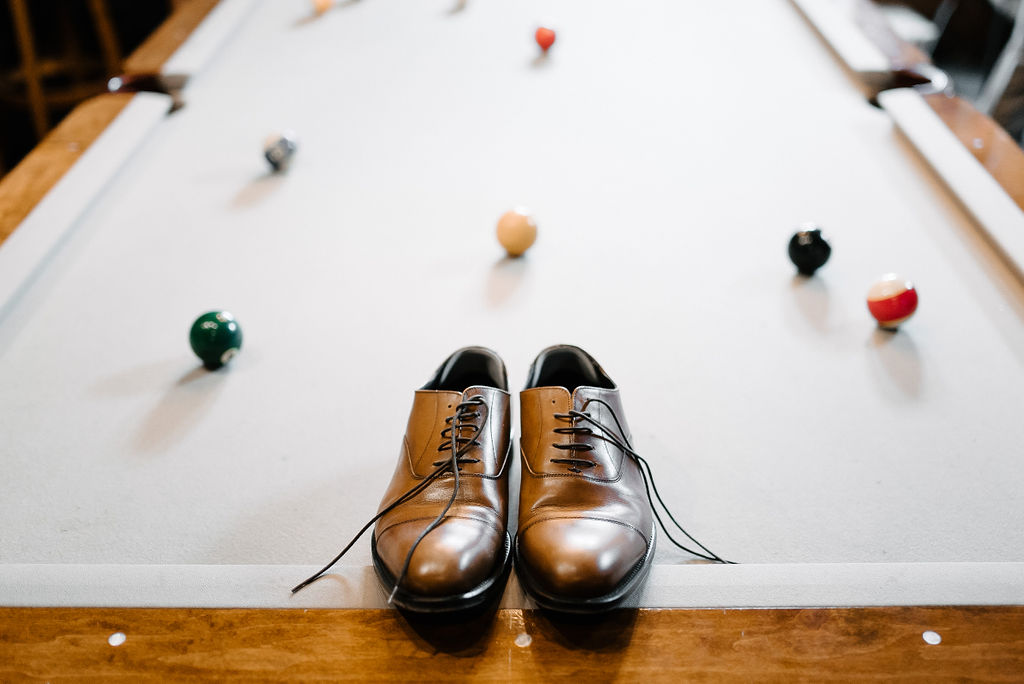 Groom Shoes on Pool Table
