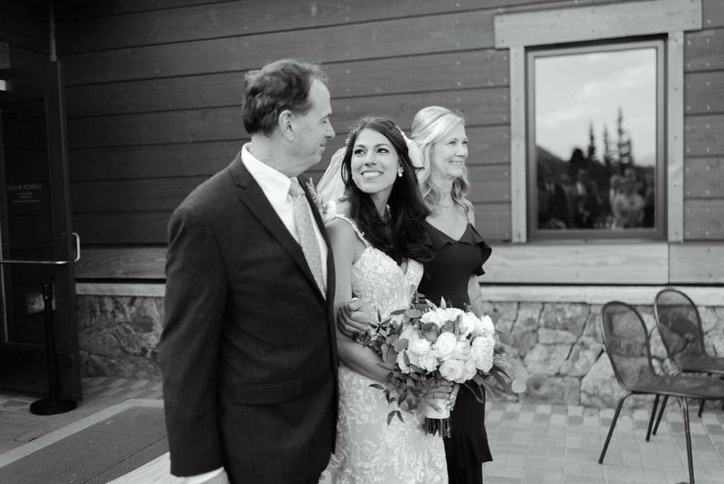 Bride and Parents Walking Down Aisle