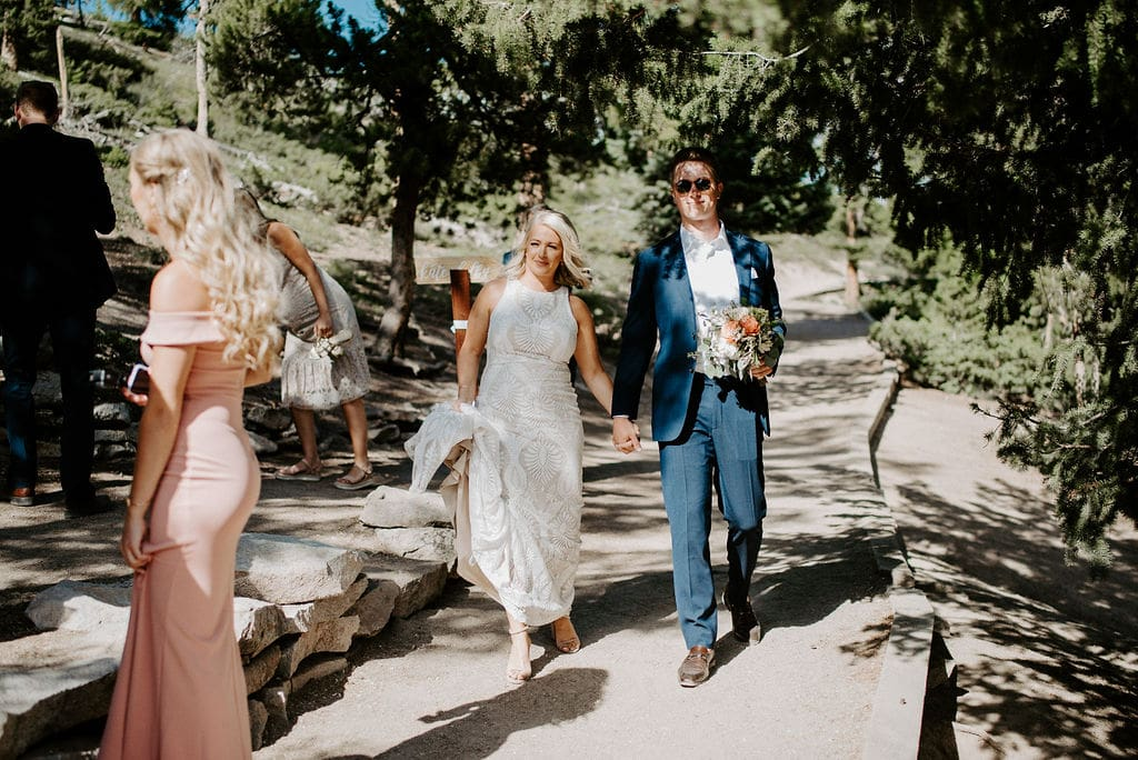 Couple walking to ceremony site