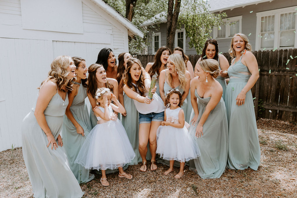 Bride with her bridesmaids before putting on dress