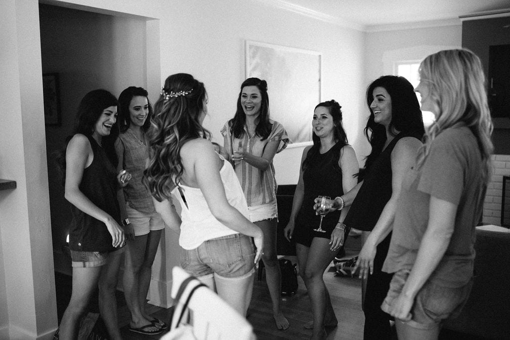Bride having fun with her friends while getting ready