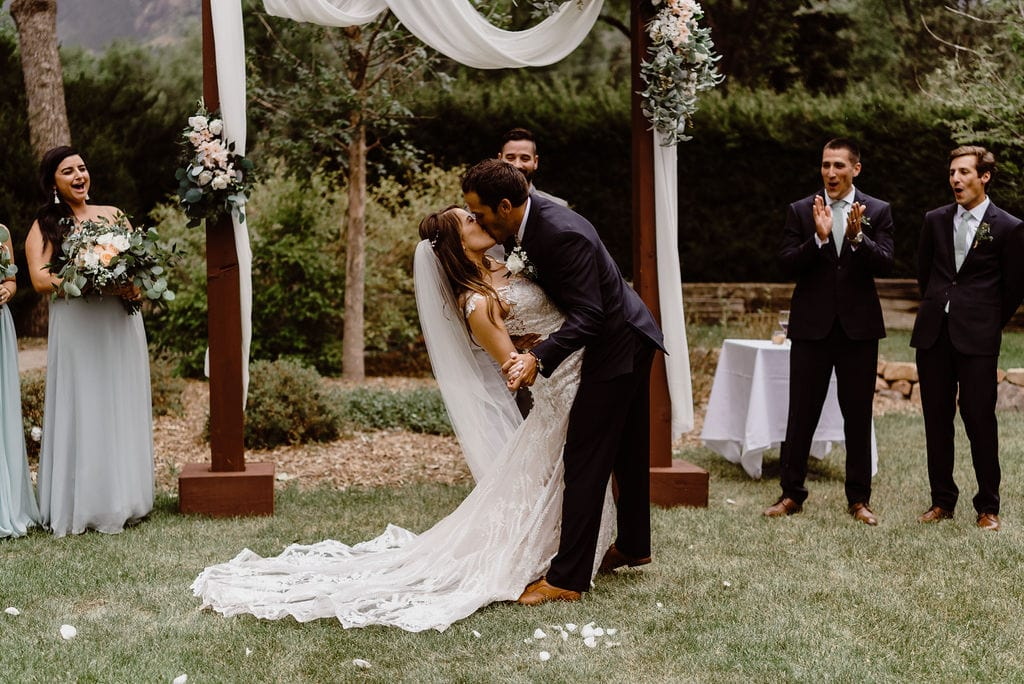Bride and Groom first kiss at Cheyenne Mountain