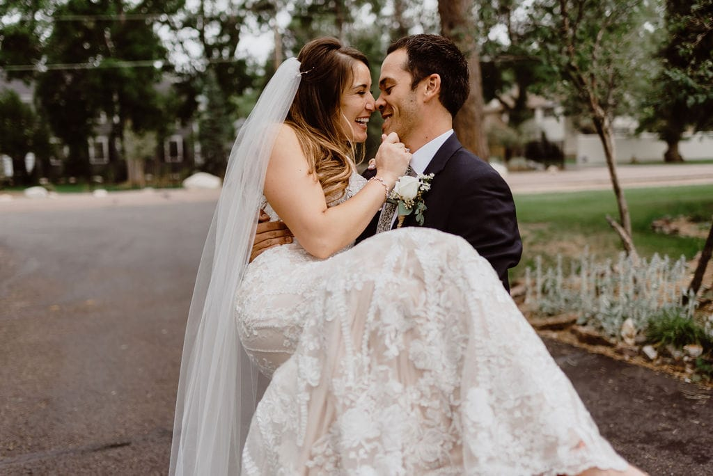 Bride in grooms arms at Cheyenne Mountain Country Club