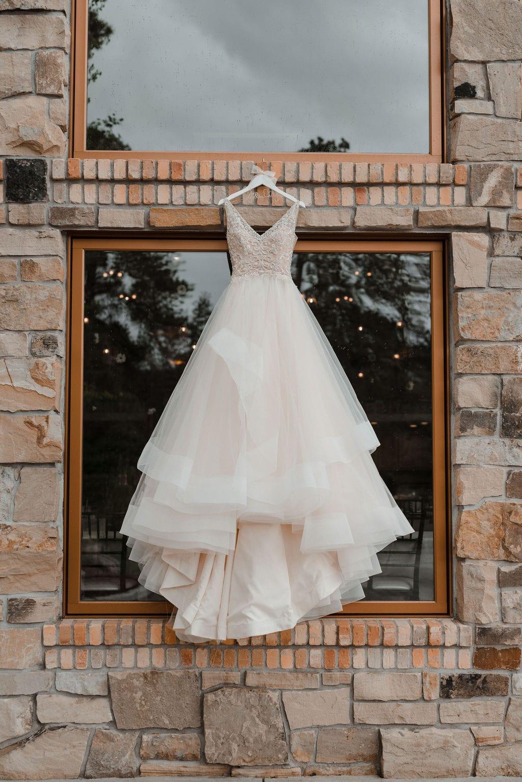 Wedding Dress hanging on the side of Della Terra Wedding Venue