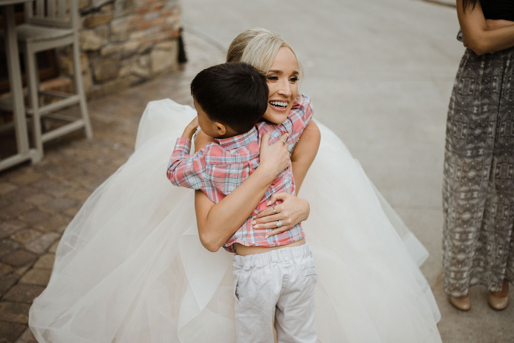 Bride with child at reception