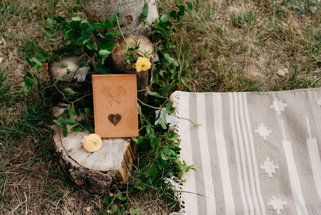 Elopement details with rug at ceremony site