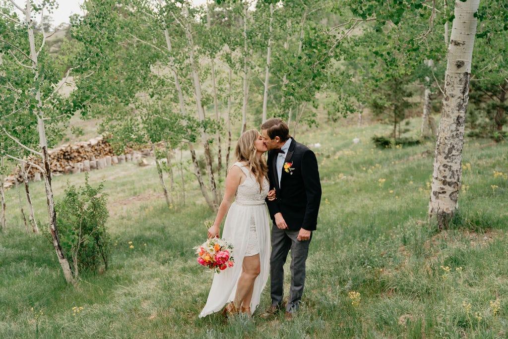 Romantic bride and groom portraits in golden colorado aspen grove