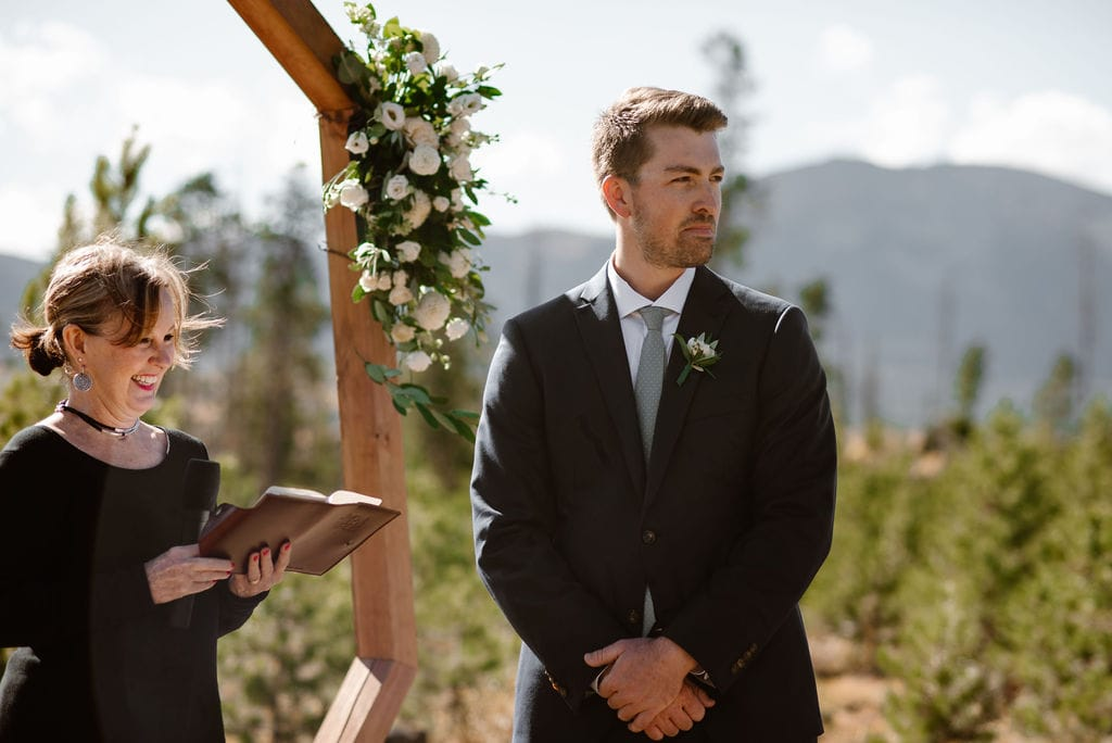 Groom patiently awaiting his bride at their windy point campground wedding ceremony
