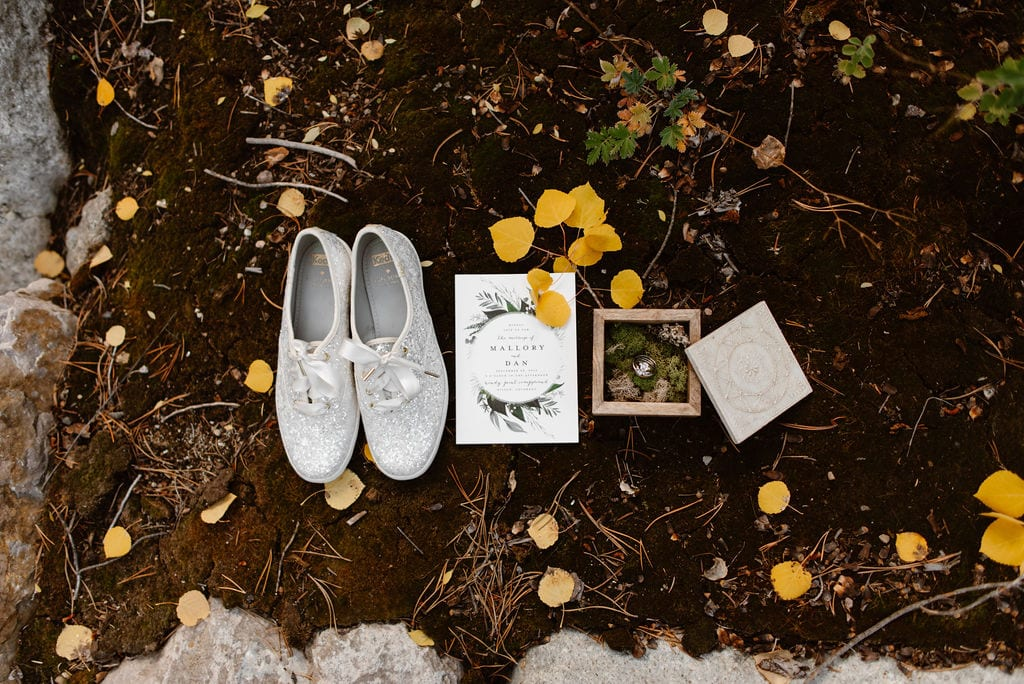 Fall wedding bridal details such as shoes and invitations and rings