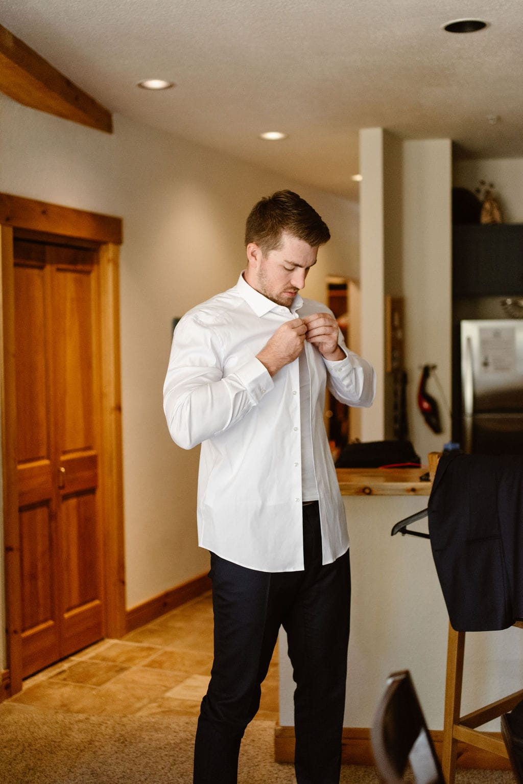 Groom getting ready for his windy point campground wedding