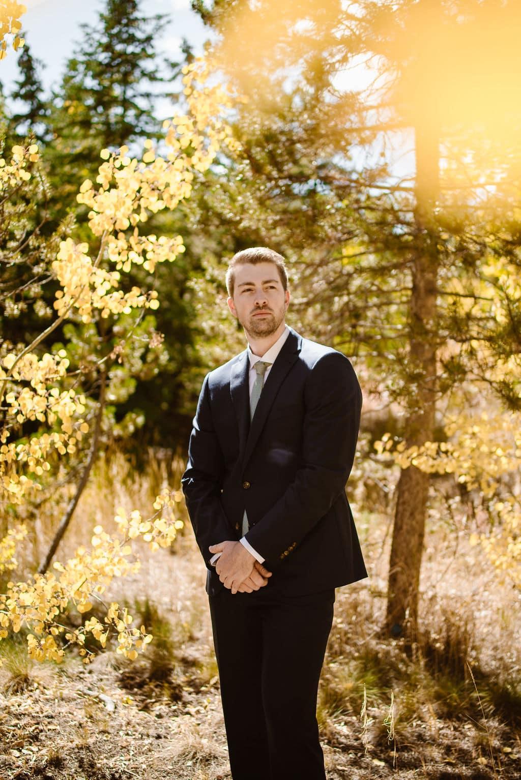 Groom portraits in an aspen grove in Keystone Colorado