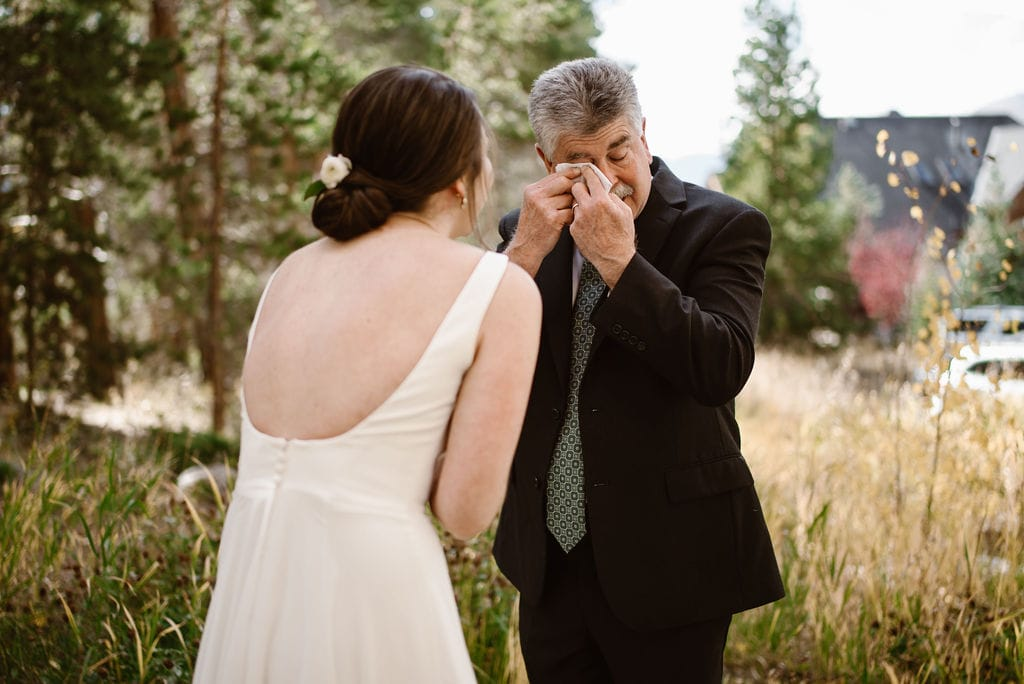Father crying when he sees his daughter for the first time on her wedding day