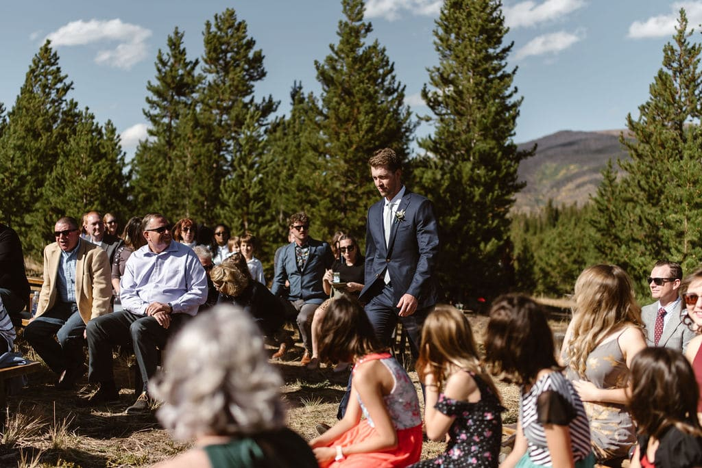 Groom walking down the aisle for his wedding in colorado