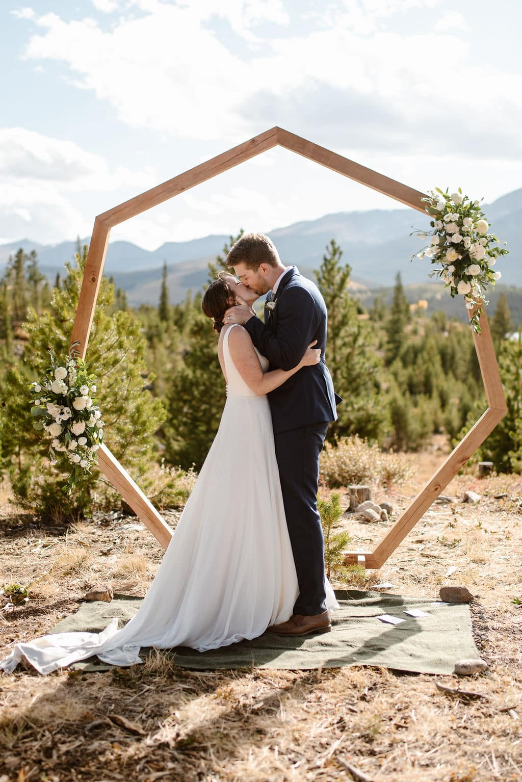 Bride and Grooms First Kiss at windy point campground wedding ceremony on Lake Dillon