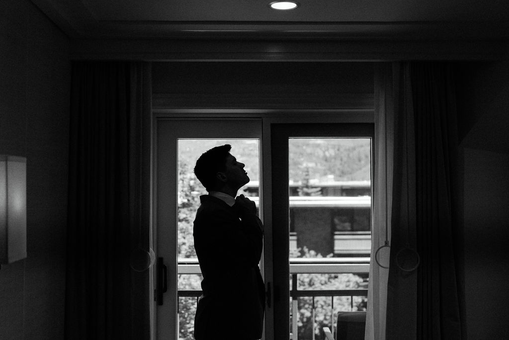 Groom getting ready at The Little Nell Hotel in Aspen Colorado