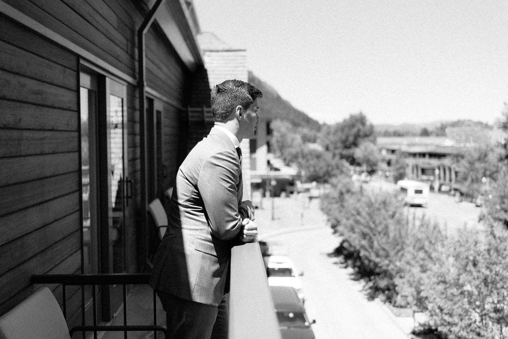 Groom on patio at The Little Nell Hotel in Aspen Colorado