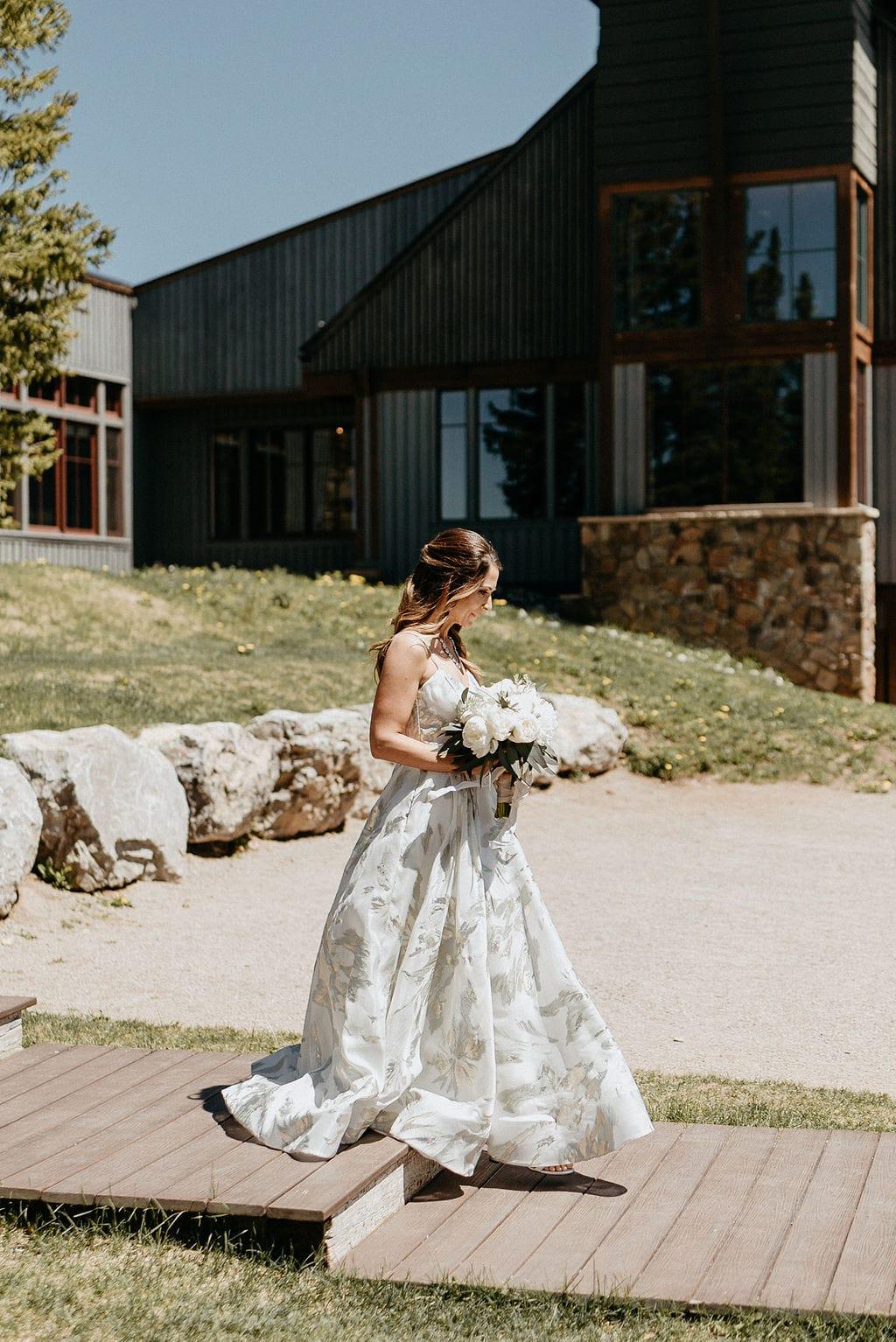 Bride walking down aisle at Aspen Little Nell Wedding