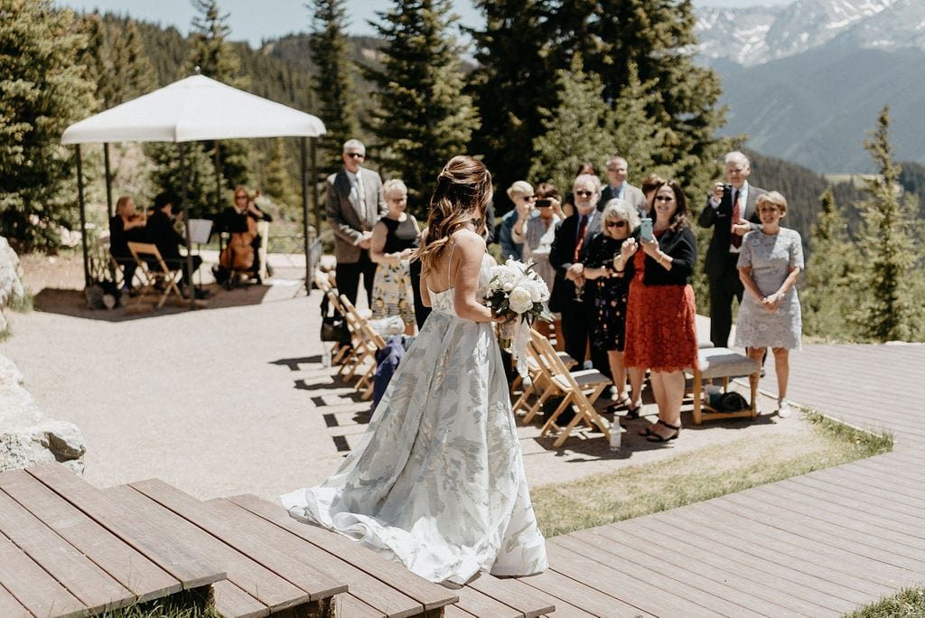 Bride walking down aisle at her Aspen Wedding at the Little Nell