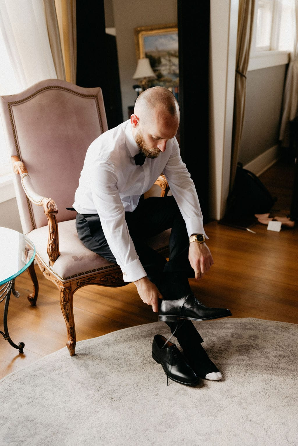 Groom gets ready for his littleton colorado wedding at the manor house