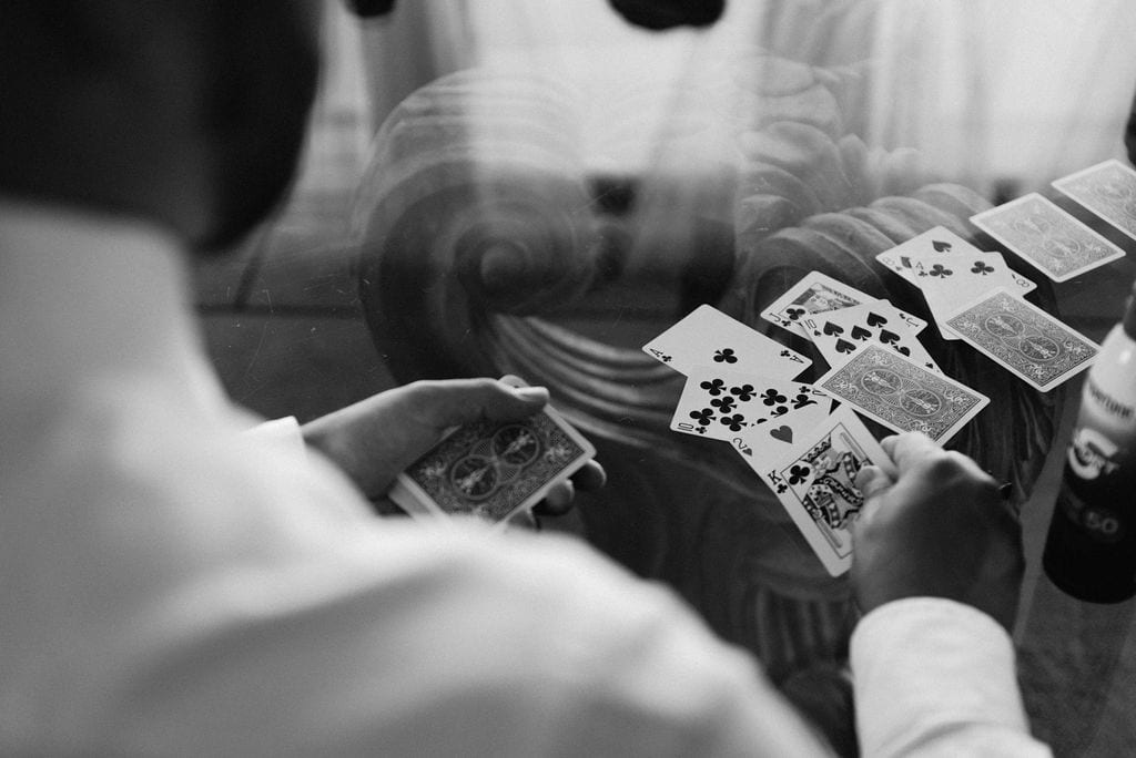 Groomsmen playing cards at the wedding