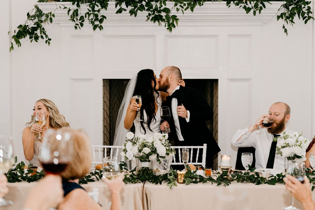 Bride and Groom Kissing at The Manor House during reception