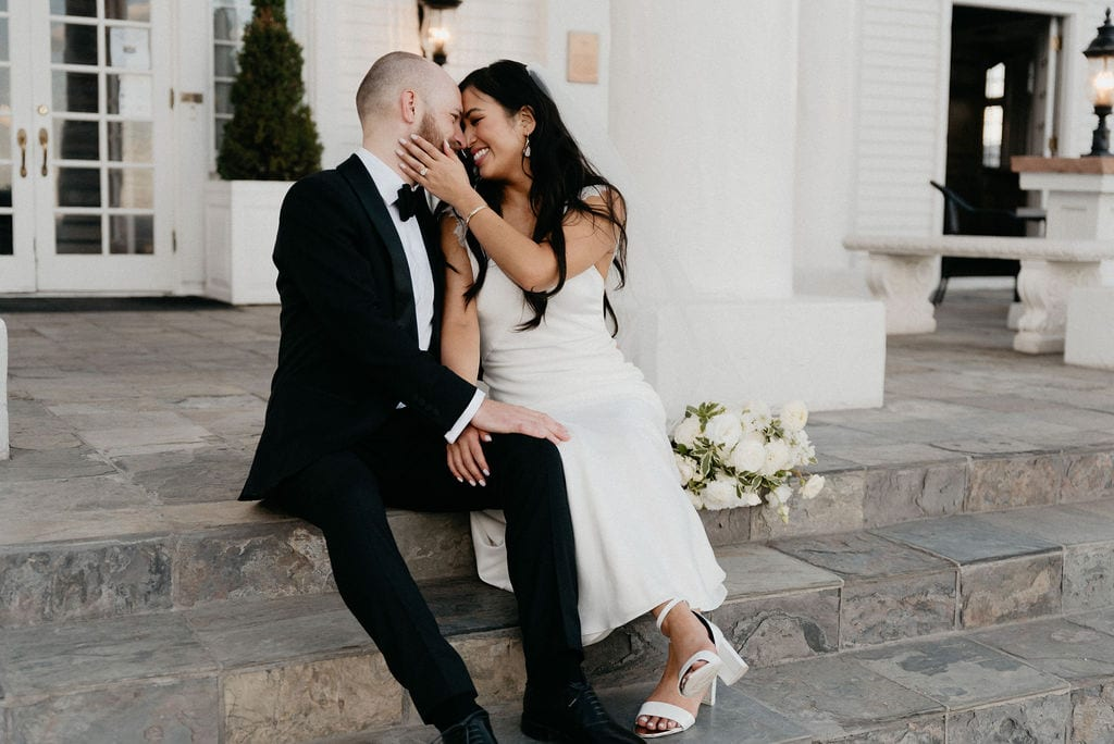 Bride and Groom Portraits at The Manor House on the porch