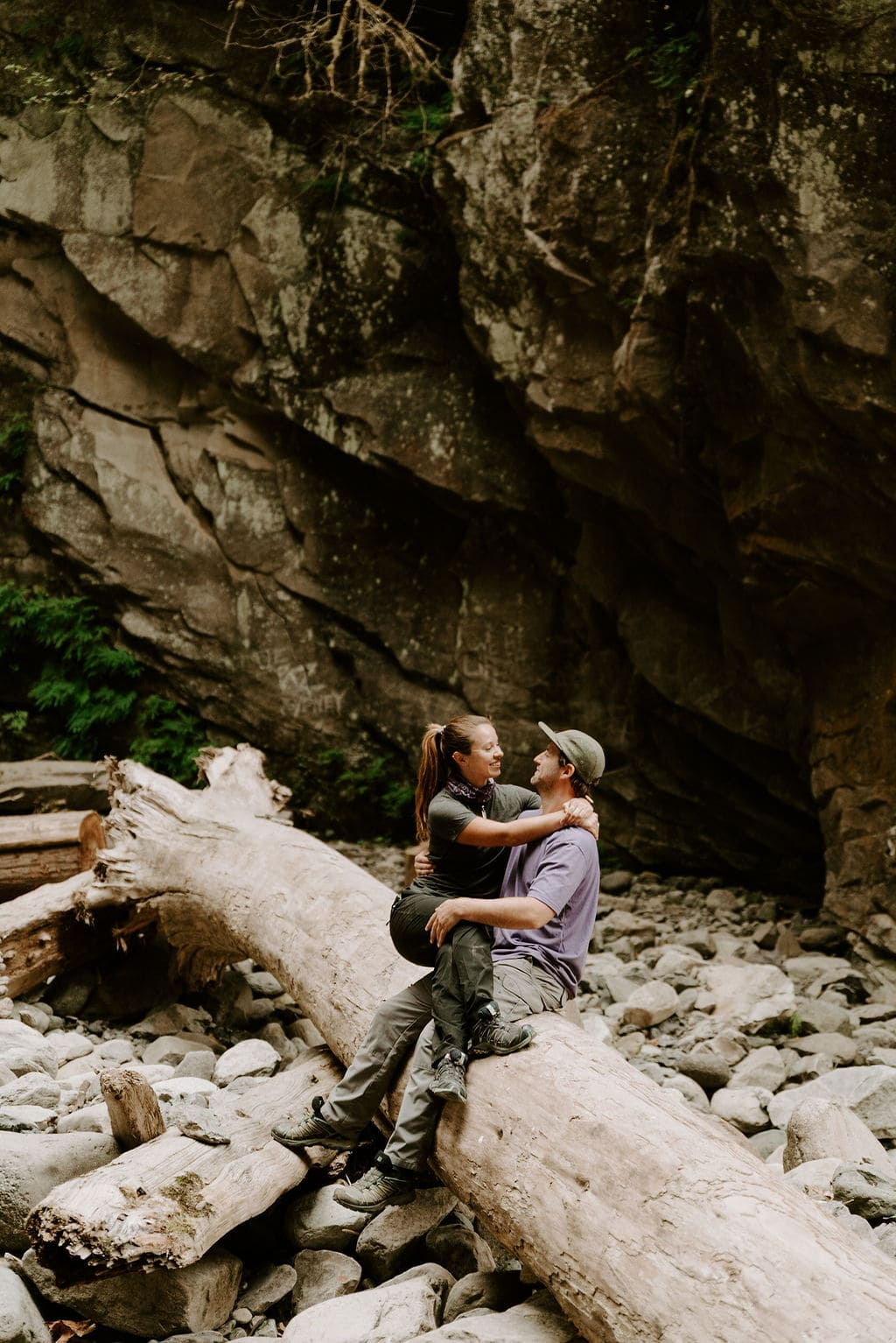 Hiking couple cuddles in PNW