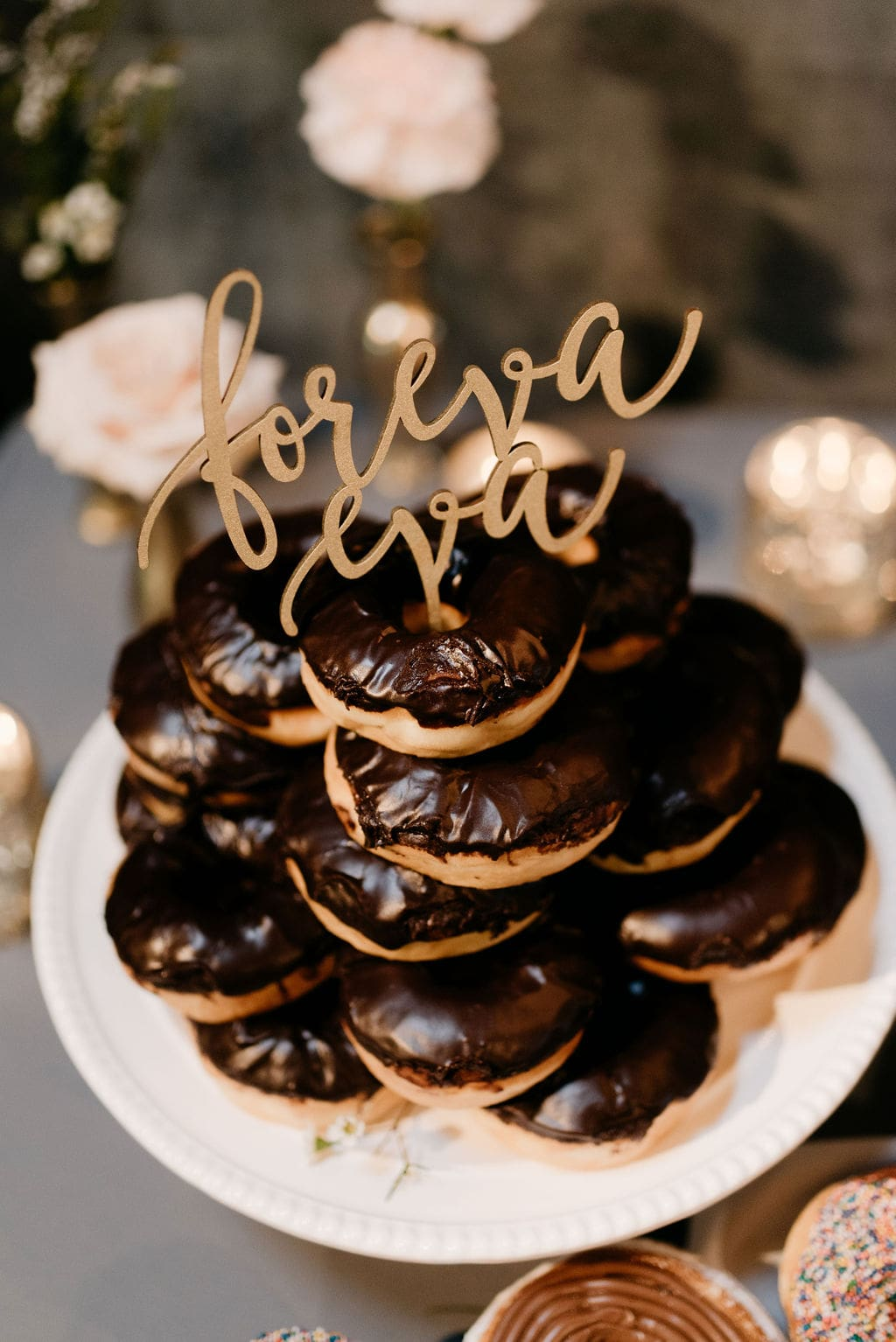 """Donuts at wedding with cake topper that says """"foreva eva"""""""