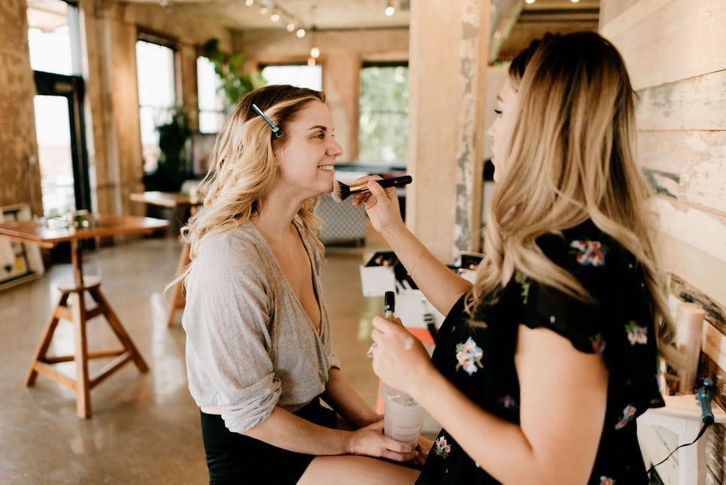 Bride getting hair and makeup done at hickory street annex wedding.