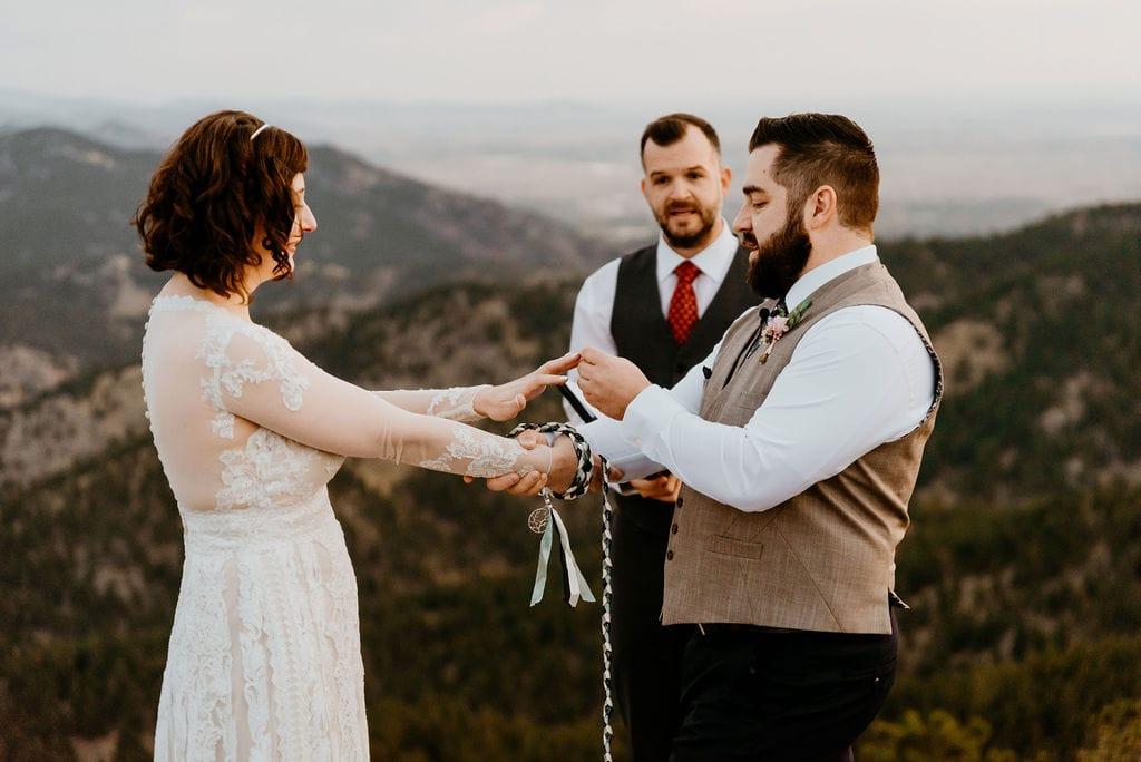 Bride and Groom exchange Rings at Boulder Elopement