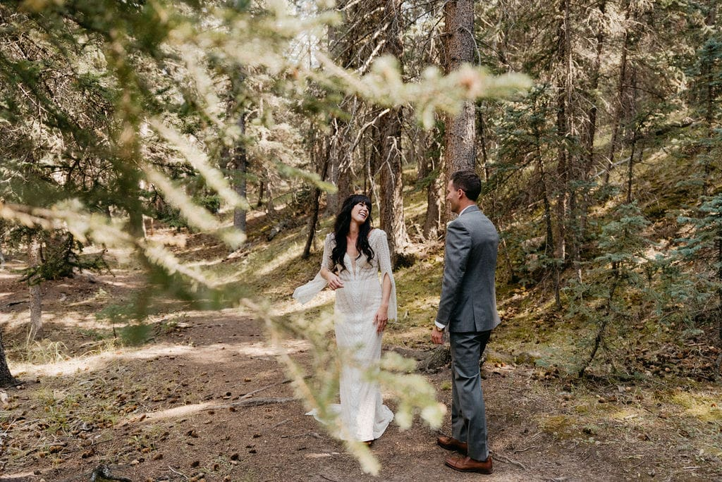 Bride and groom first look at mountain view ranch