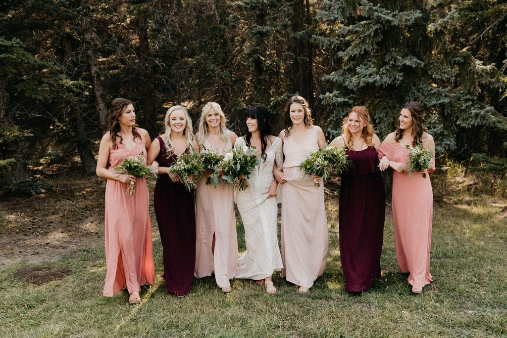 Bridesmaids with blush and plum dresses