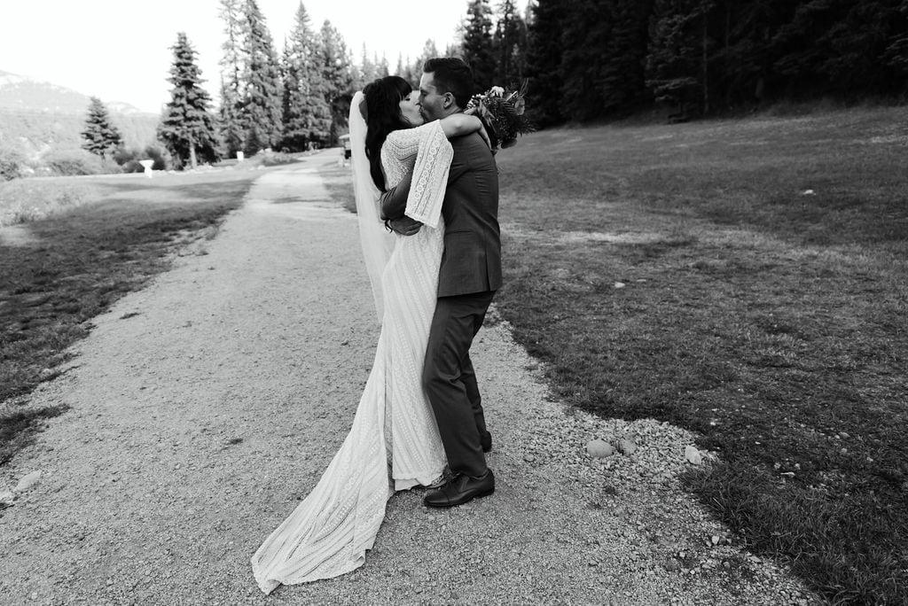 Bride and groom walk away as newlyweds