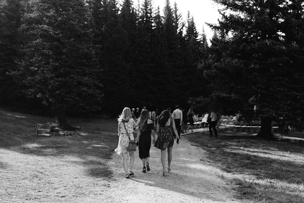 Guests headed to wedding ceremony in pine colorado