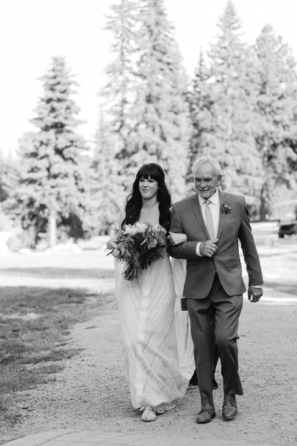 Bride walks down ceremony aisle with her dad