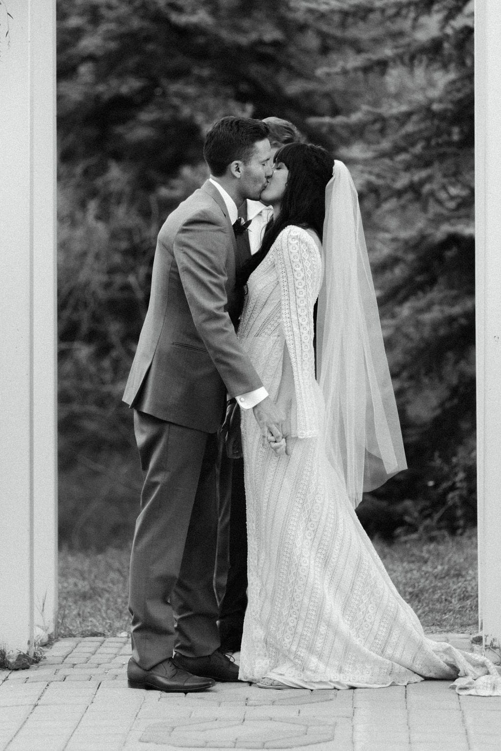 Bride and groom first kiss at mountain view ranch