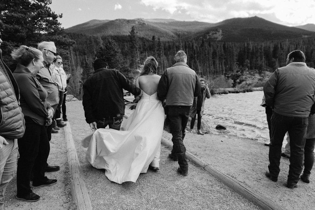 Brides dad helps her to her wedding