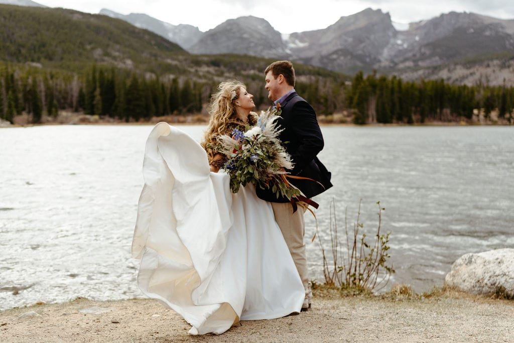 Bride and groom at their windy wedding ceremony at sprague lake in rocky mountain national park