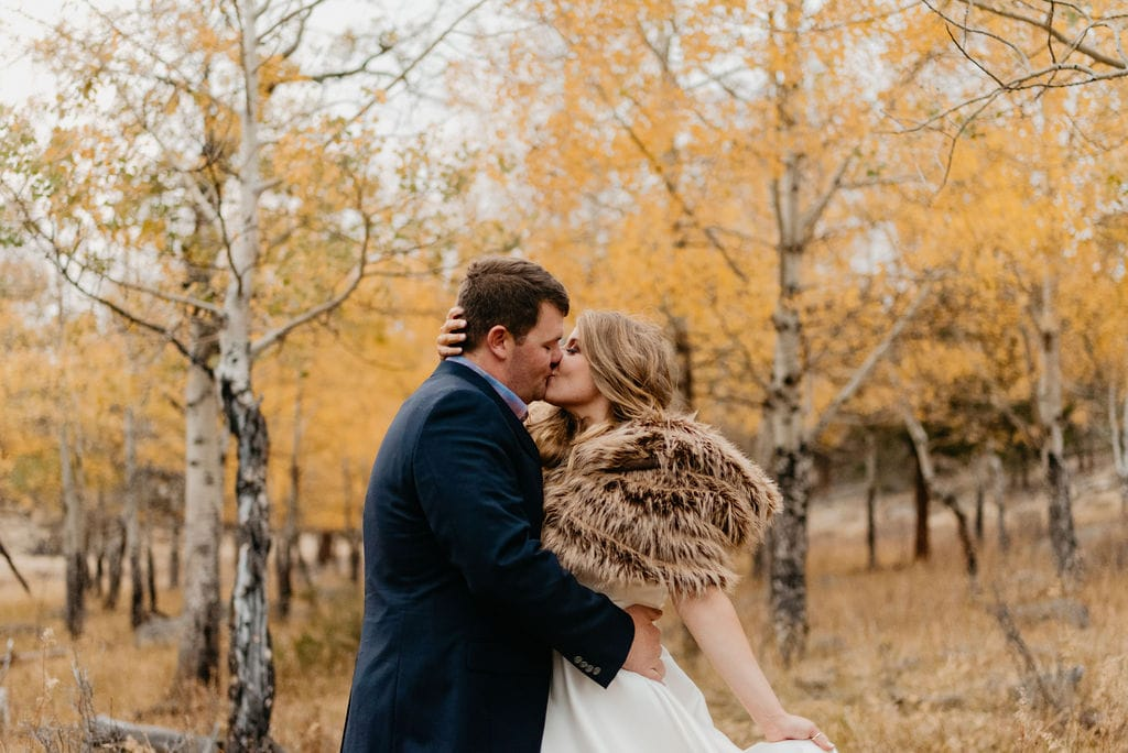 Romantic sunset portraits in the rain in rocky mountain national park