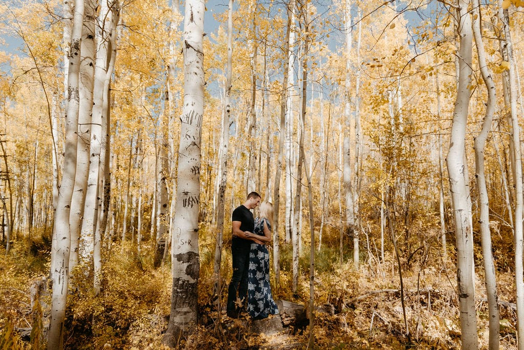 Couple in Vail Kisses Amongst Yellow Aspens