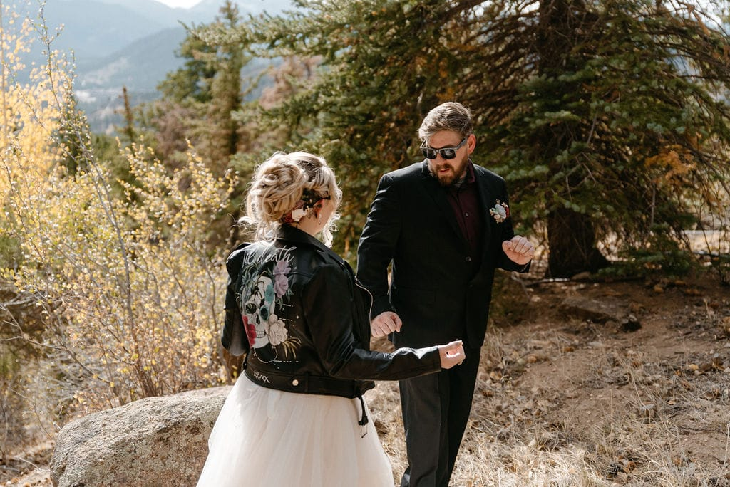 Excited groom gets to see his bride for the first time at their first look before their hermit park elopement