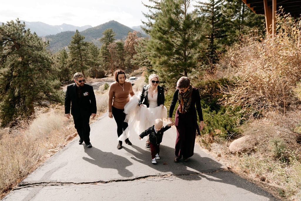 family gets ready to leave for their estes park elopement