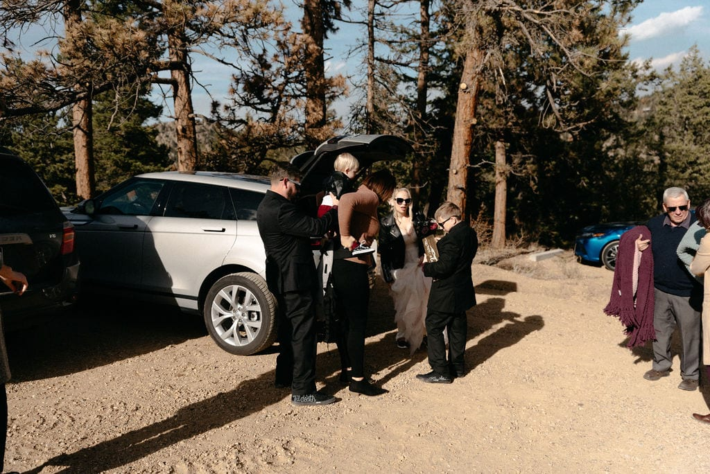 unpacking the car to hike for their estes park elopement