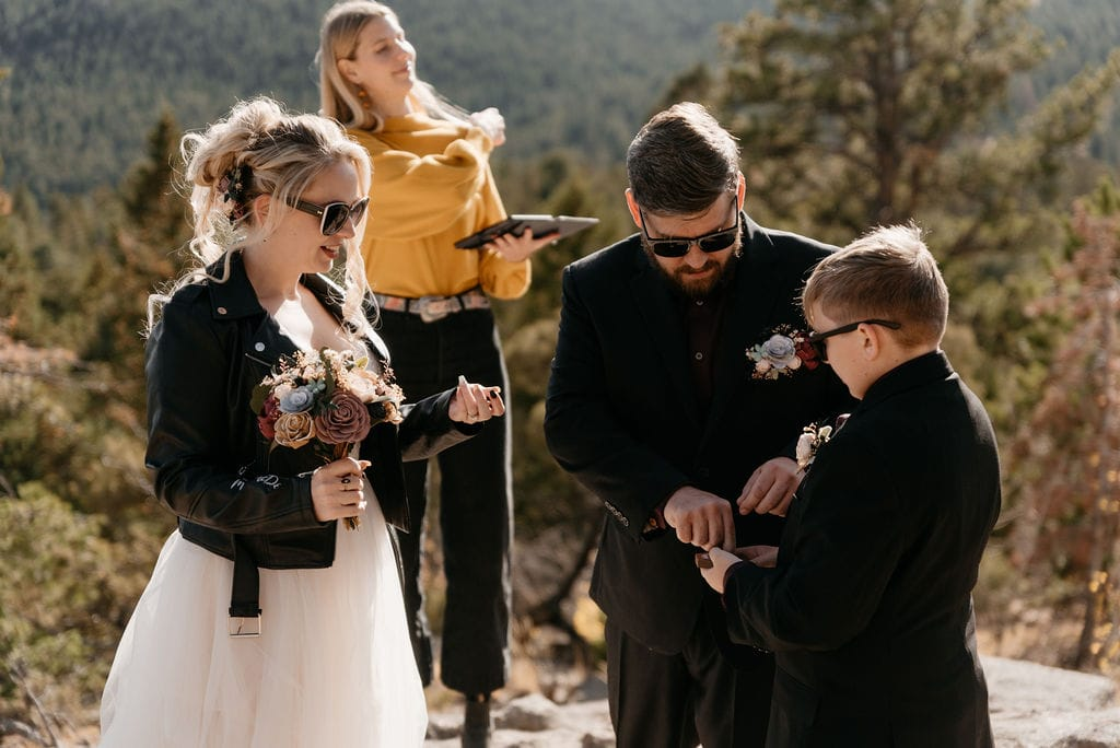 Son gives rings to mom and dad at their hermit park elopement