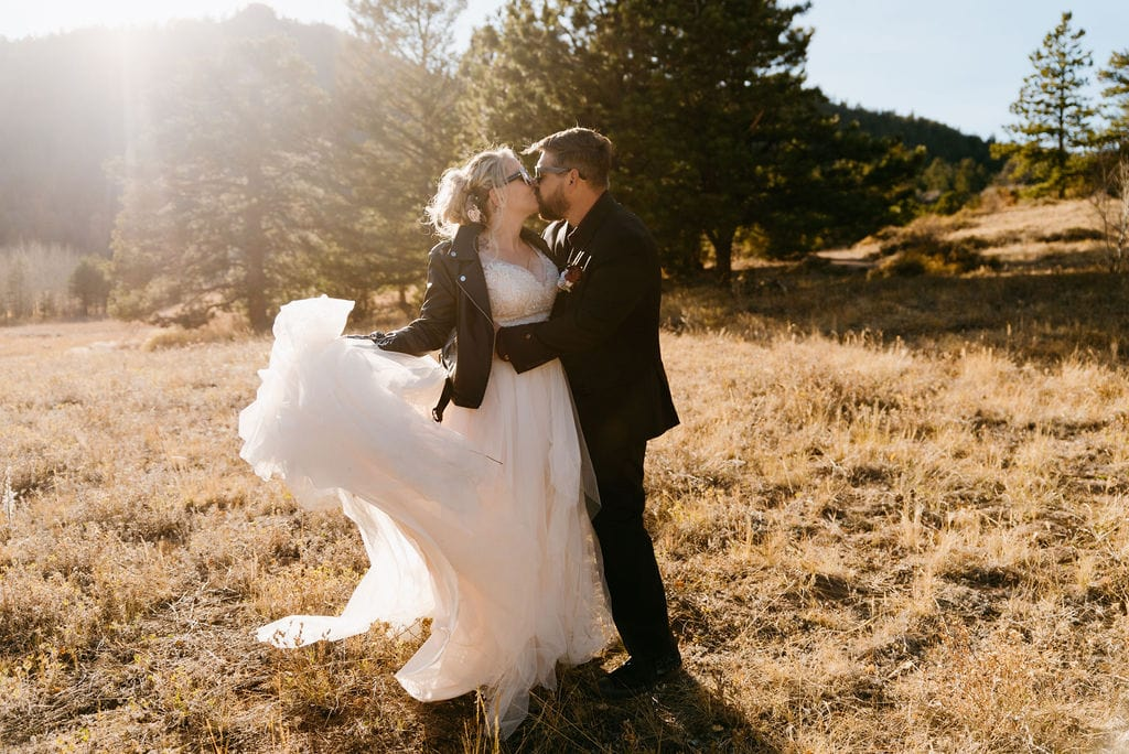 Romantic bride and groom portraits in the mountains in estes park