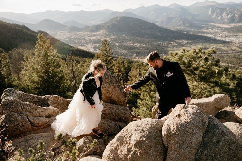 Hiking bride and groom on kruger rock trail